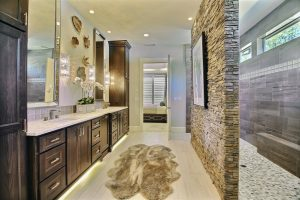 Master Bath with Custom Cabinetry, Rock Accent Wall, ADA/Roll-In Double Shower 1 of 2