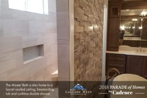 Master Bath with Barrel Vaulted Ceiling, Eldorado Stone Textured Rock Wall, Separate Vanities and a Walk-In Curbless ADA Double Shower.