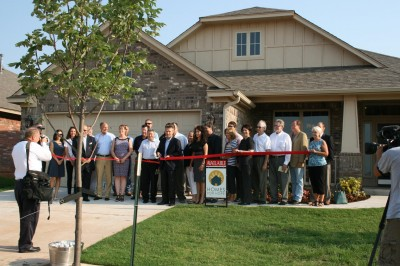 Group Ribbon Cutting Homes for Hope and Ideal Homes