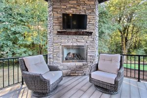 Gas Fireplace, Stone Surround, Live Edge Mantel, TV and Seating provide the perfect place to relax in any weather
