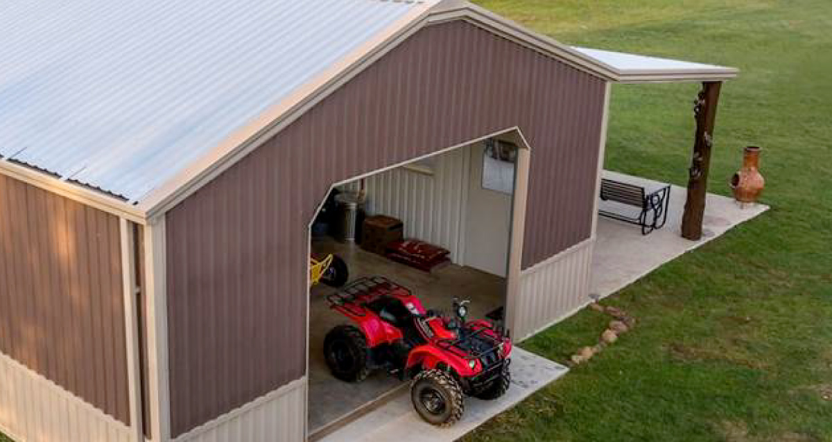 Brown outbuilding with a red tractor parked in front