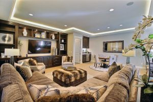 The Man-Cave Home Theater with Custom Built-In Media Wall and Corner Wet-Bar and Beverage Station