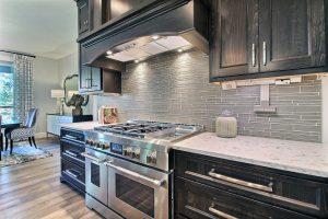 Corner Kitchen - Custom Cabinetry, Backsplash, Framing and Range