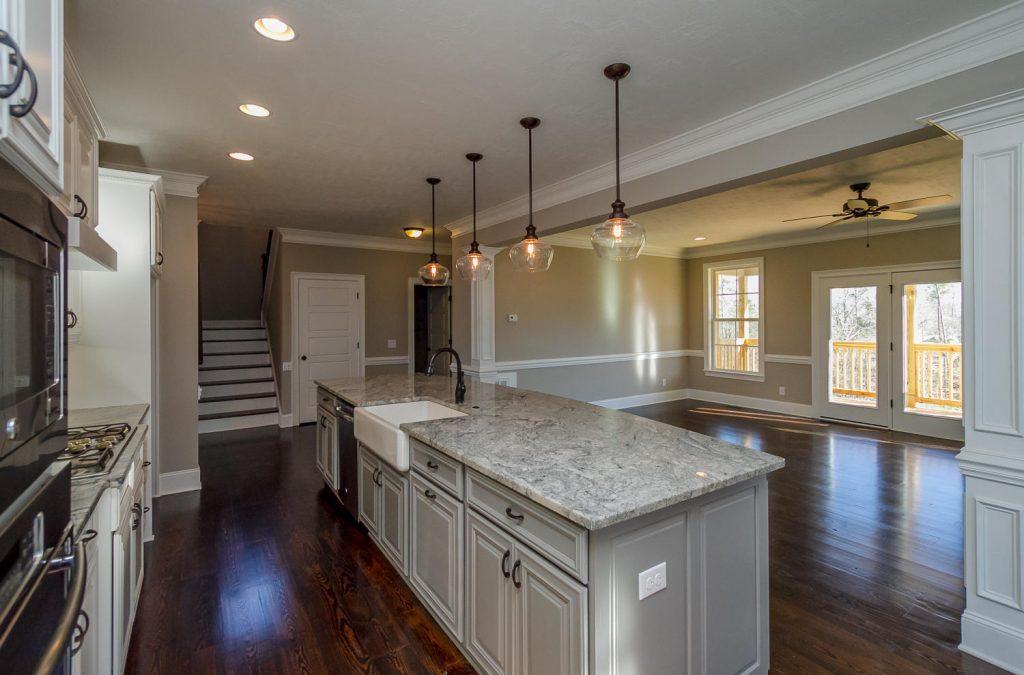 Open floor plan kitchen, hardwood floors, with large kitchen granite island for barstools
