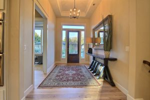 The Foyer with Coffered Tray Ceilings and the Home Office w/ Beverage Station