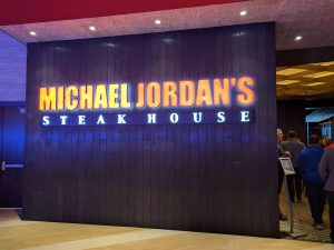 The Michael Jordan's Steakhouse Storefront. On opening day there was quite the line, but with good reason! We loved this signage and the adjacent texture wall.