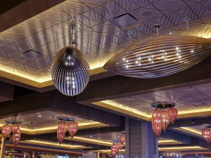 Very interesting lighting fixtures above the gaming floor. We found these to be quite beautiful in construction and presentation. Those well lit coffered ceilings are working well in this space!