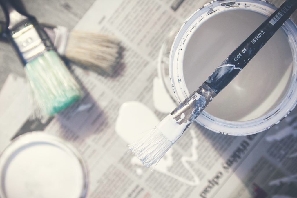 Change Up the Couch Pillows, white paint, paint brushes