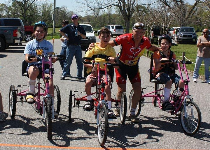 founder Jairo Alvarez rides bikes with children with special needs