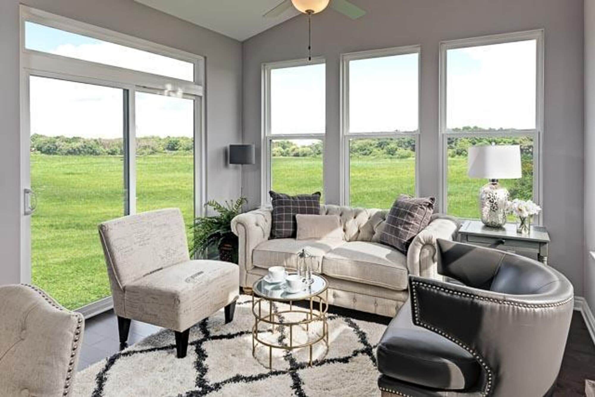 An in-home sunroom representing the benefits of sunrooms sold by custom homebuilders Robertson Homes in Michigan