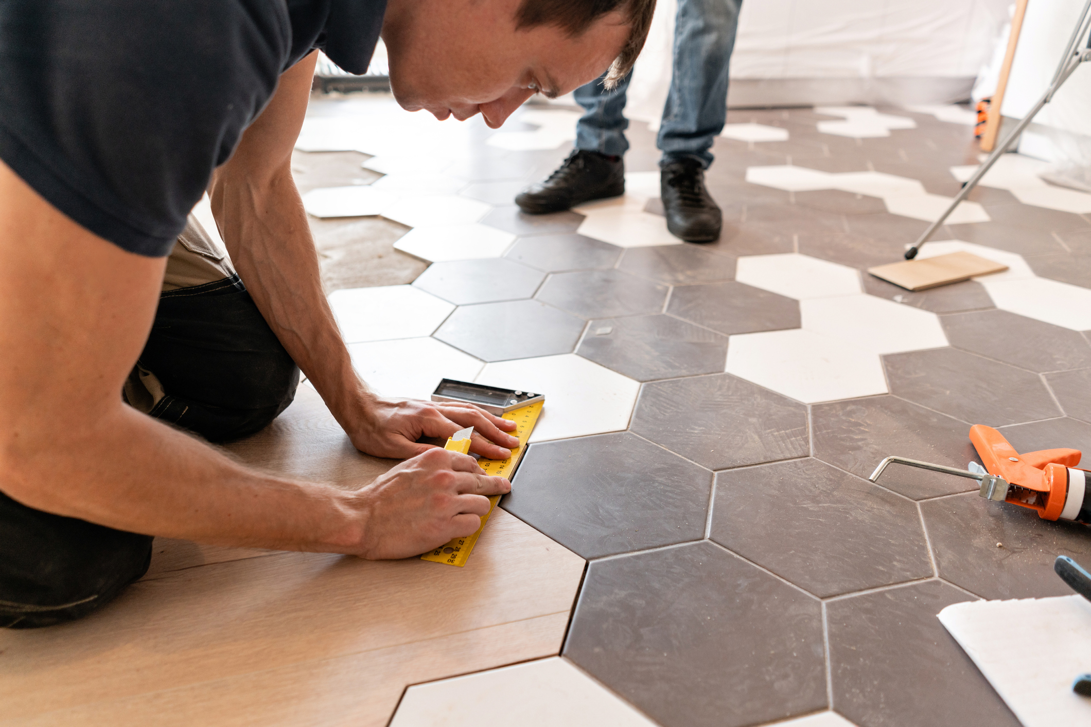 Man renovating the tile floor in his home