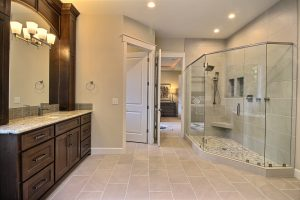 Glass and Tile Walk-In Mud Set Shower, Vanity and Water Closet