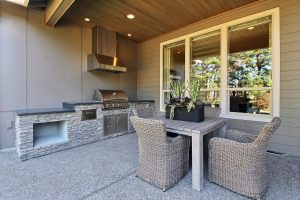 Outdoor Living Area with Stone Fireplace Surround, Seating, Water Feature, Cooking, and Dining 2 of 2