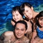 Happy family in pool of a Weston Dean Custom Home
