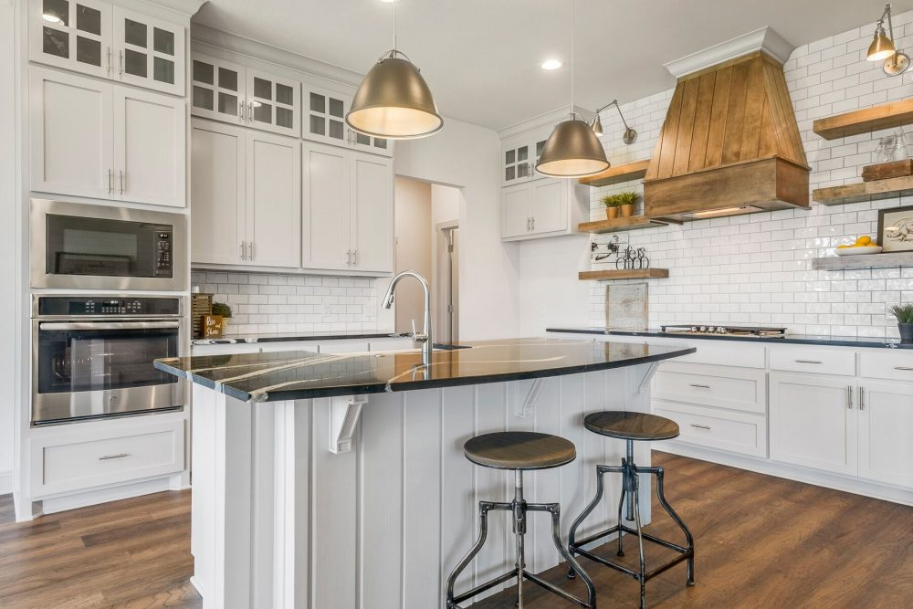 Kitchen stained wood hood gray cabinets