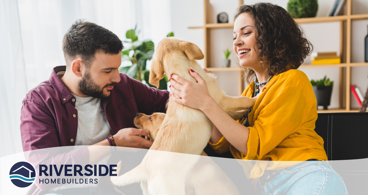 Image of a couple with their puppy.