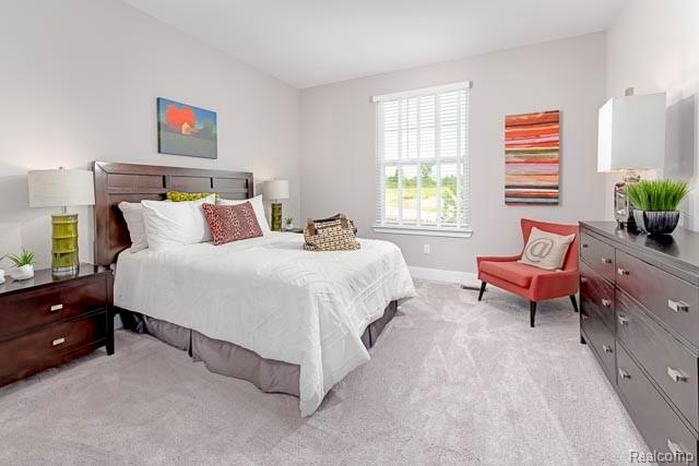 A bedroom with white walls and carpet