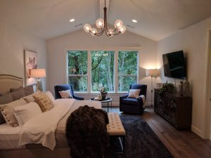 The Master Bedroom with Vaulted Ceilings and a Beautiful View from The Overbrook
