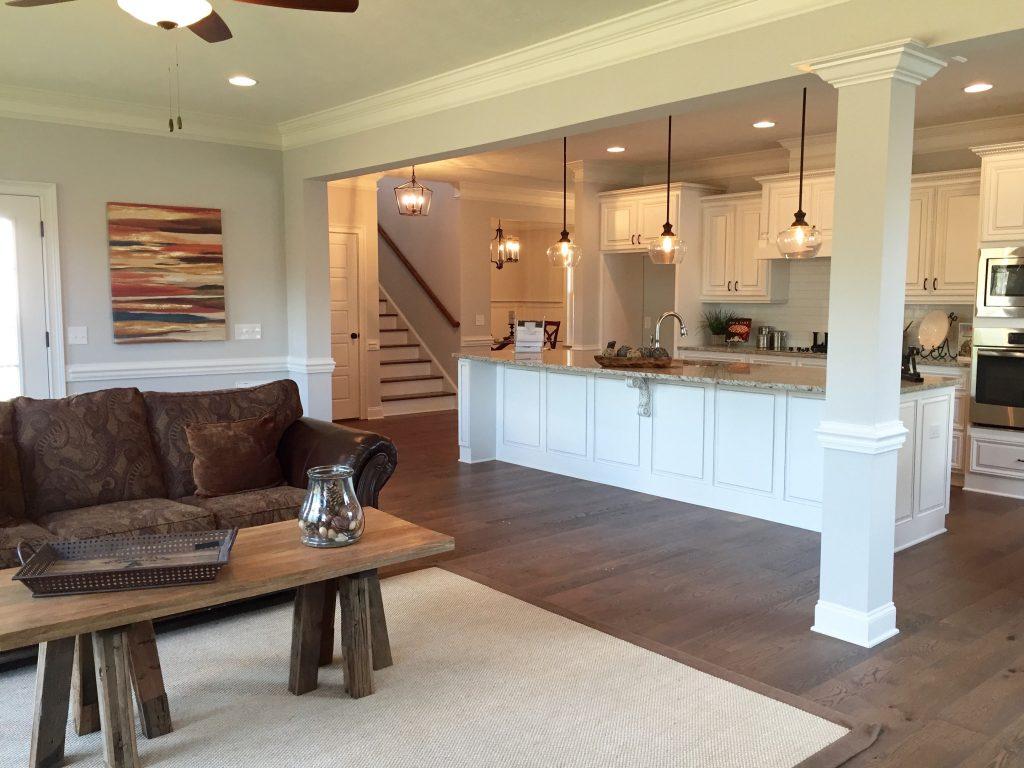 Barstool kitchen island with granite countertop, open floor plan for entertaining