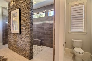 The Roll-In / Curbless ADA Double Shower and Water Closet in The Turtledove's Award Winning Master Wing
