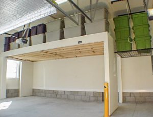 A Garage Loft. High Garage Ceilings Are A Great Solution To Free Up Storage  Space In Tighter Garages, As Shown In This Garage. The Pictured Loft Almost  Acts ...
