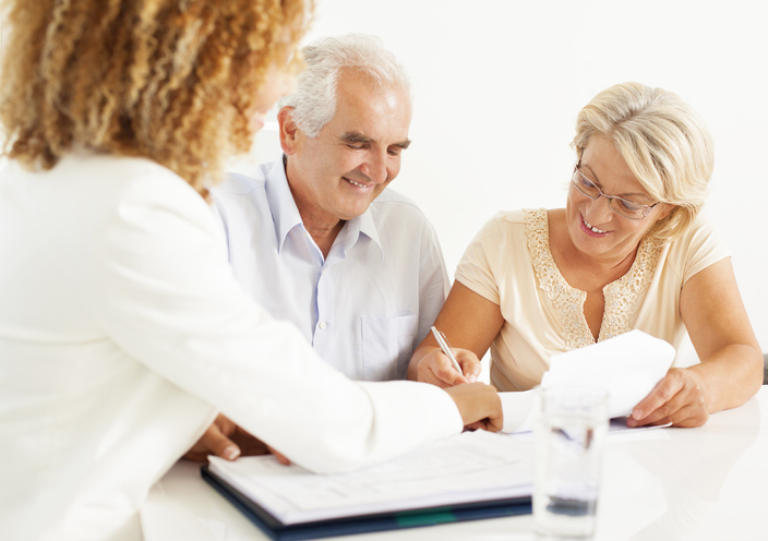 Home buyers in Boerne, Texas, signing financing documents