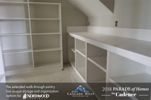 Walk-Through Kitchen Pantry with Custom Shelving and Storage Options.