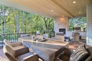 Covered Outdoor Living Area with Gas Fireplace, Dining Area, Seating Area and BBQ Station