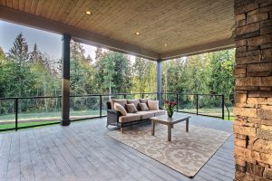 Outdoor Covered Living Area with Tongue and Groove Pine Ceilings + Chef's BBQ + Stone Fireplace Wall