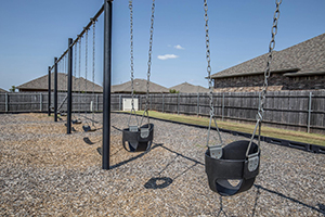 New homes in Edmond OK with a neighborhood swingset