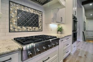 Full Height Tile Backsplash with Mosaic Accents