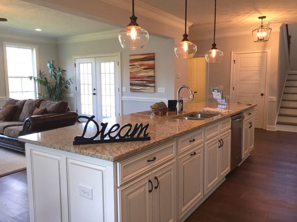 Open floor plans, large kitchen island, granite countertops