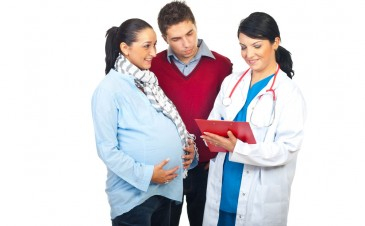 What happens at prenatal visits?