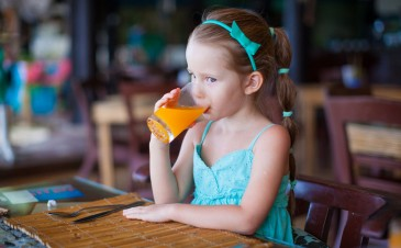 When should I begin giving fruit juice to my baby?