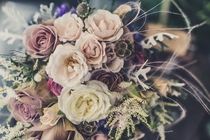 Decorate your wedding bus rental with flower arrangements that match your wedding theme.