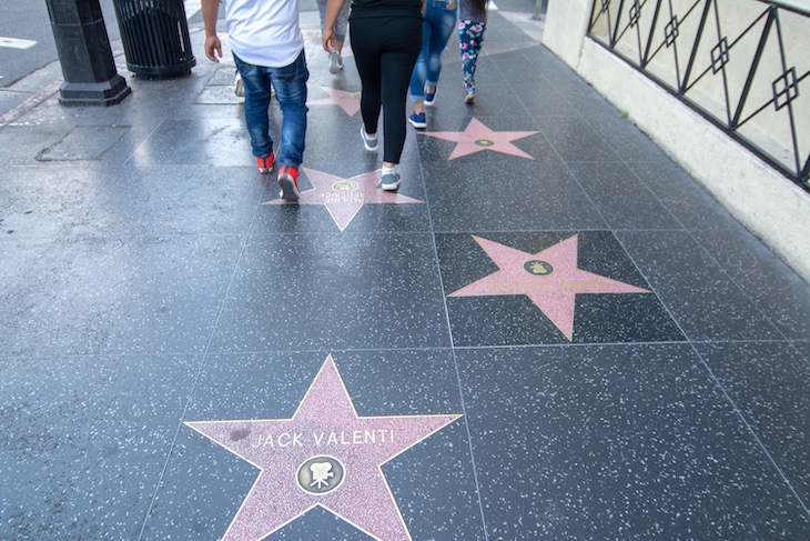 Rent a charter bus from LAX to the Hollywood Walk of Fame.