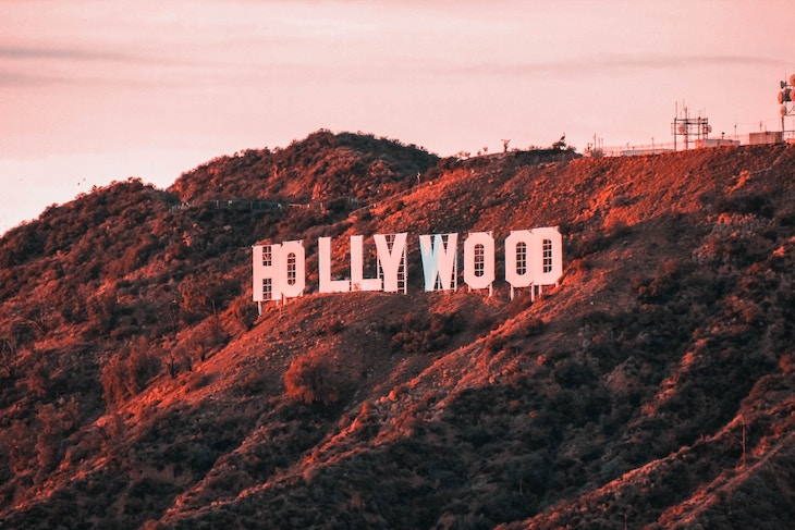 Rent a charter bus from LAX to the Hollywood Sign.