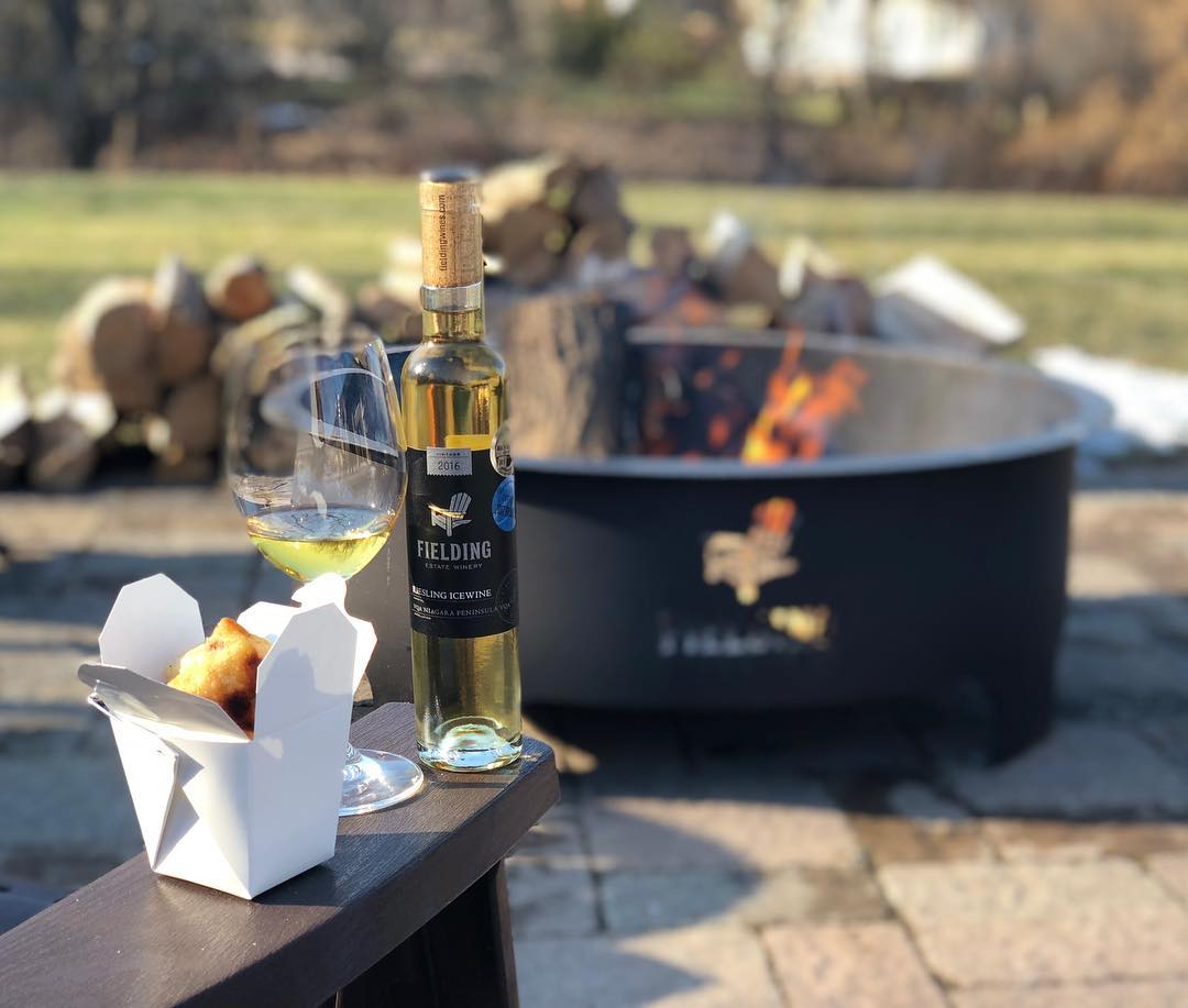 Enjoy a glass of Fielding's Winery by the fire-pit. Get to this Niagara winery with a charter bus rental