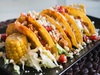Homemade-chicken-tacos-with-corn-and-cheese_449-19325842