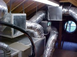 Hard pipe ductwork running from horizontal application.