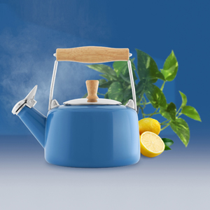 enamel on steel sven teakettle natural wood handle & knob scandinavian collection 1.4 quart capacity in action