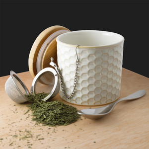 ceramic tea caddy with bamboo lid and stainless steel infuser high-quality stoneware hand-sanded base for no-scratch surface FDA & Prop 65 approved in action