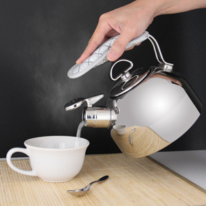 classic stainless steel teakettle 1.8 quart capacity original iconic design the only teakettle in the market to feature a two-tone Hohner harmonica whistle in action