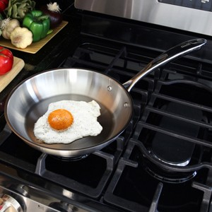 Stainless Steel frypan chantal induction 21 steel collection premium no nickel non-toxic cookware 10 inch diameter brushed exterior in action frying an egg on cooktop