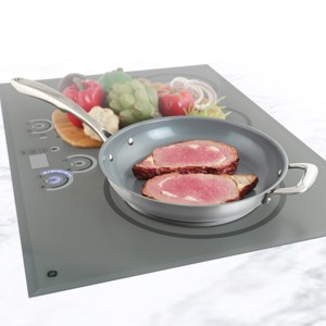 Stainless Steel frypan with ceramic non-stick coating chantal induction 21 steel collection no nickel non-toxic cookware 11 inch diameter in action cooking steaks