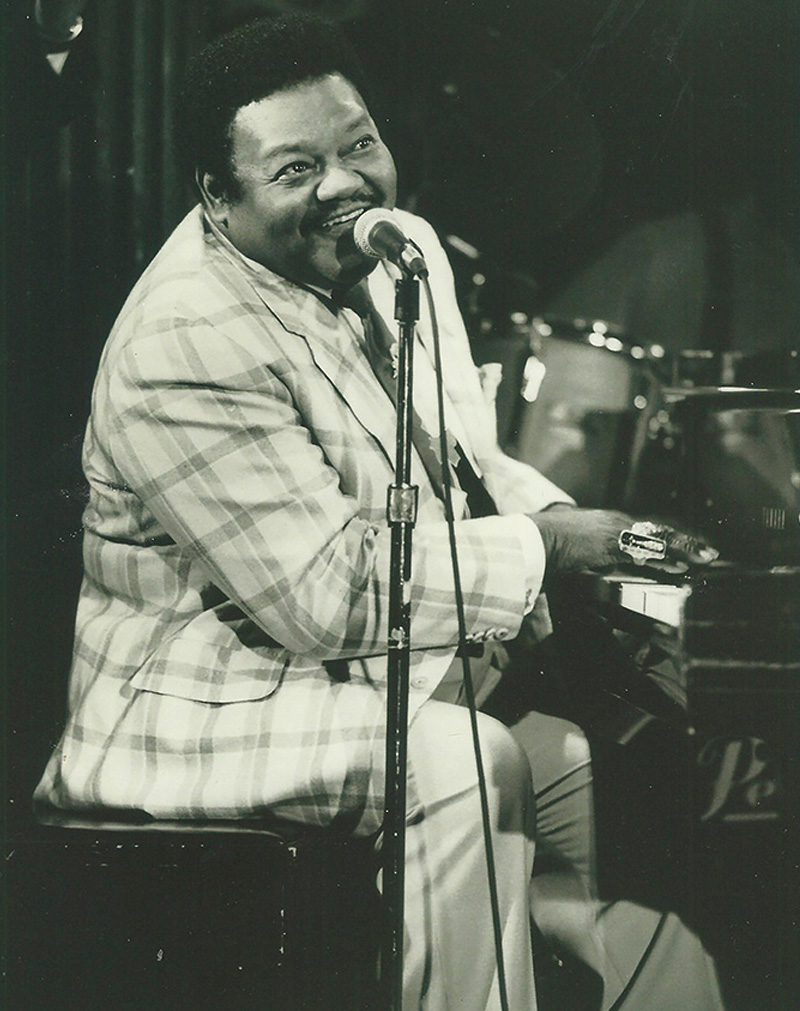 Fats Domino performing at the piano