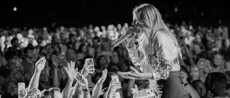 black and white photo Kelsea Ballerini on the stage