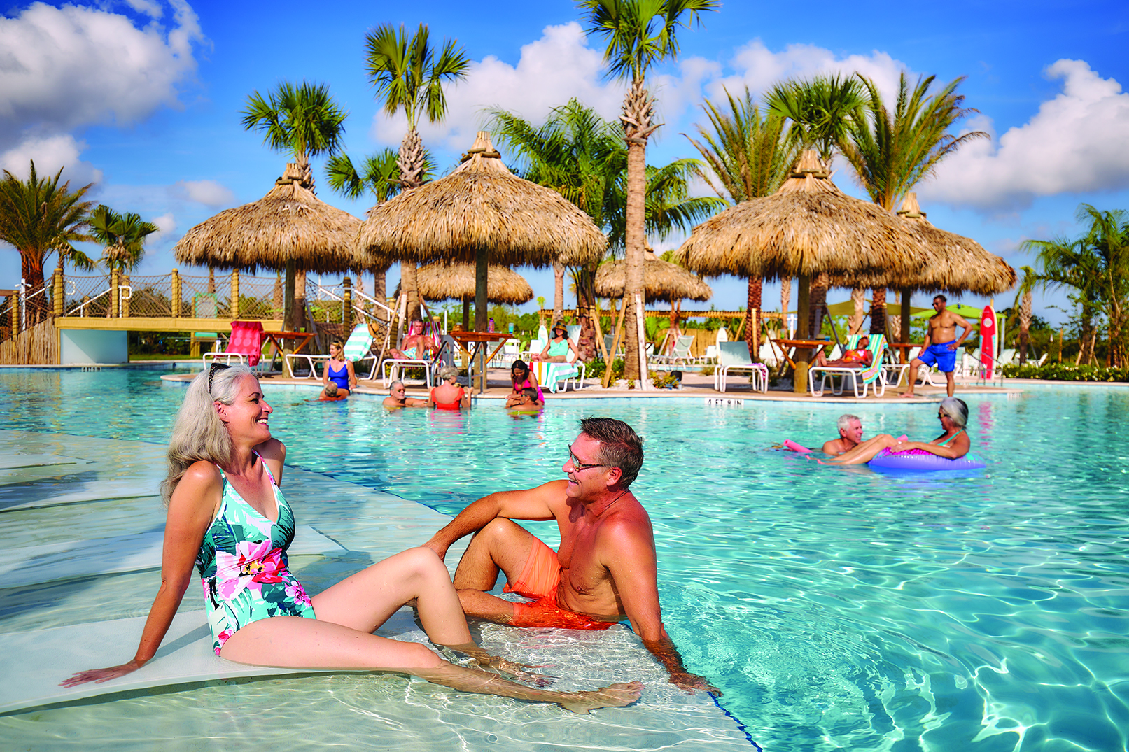 Residents gather around the island-inspired pool, cabanas and refreshment bars