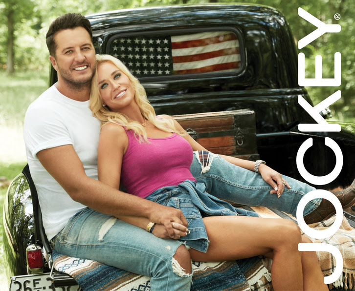 Luke and Caroline Bryan with Jockey logo in back of truck