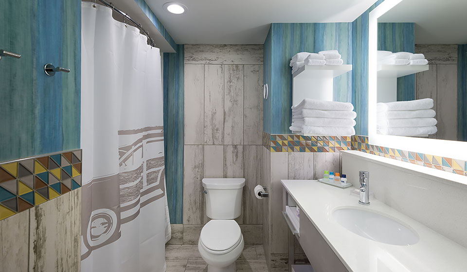 well appointed bathroom with colorful, island-inspired finishes and marble tile